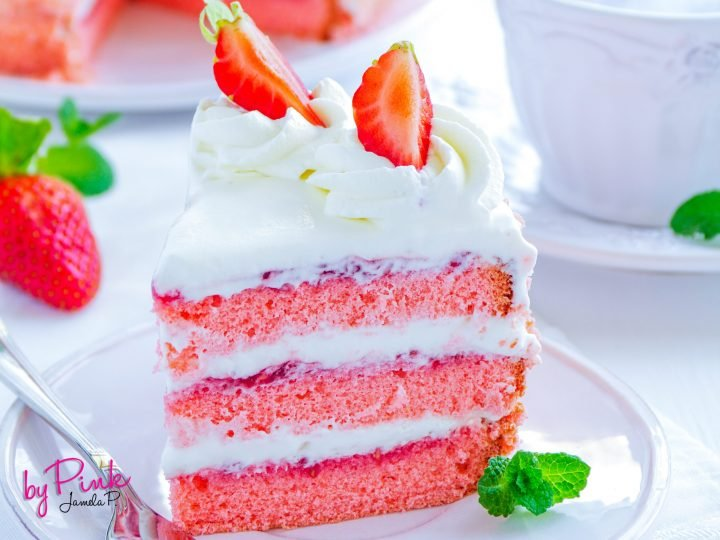 strawberry Cake with strawberries white icing and strawberry jam.