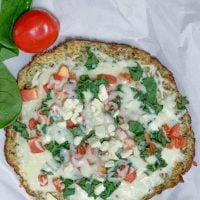 Cauliflower Pizza Crust With Tomato Spinach and Feta