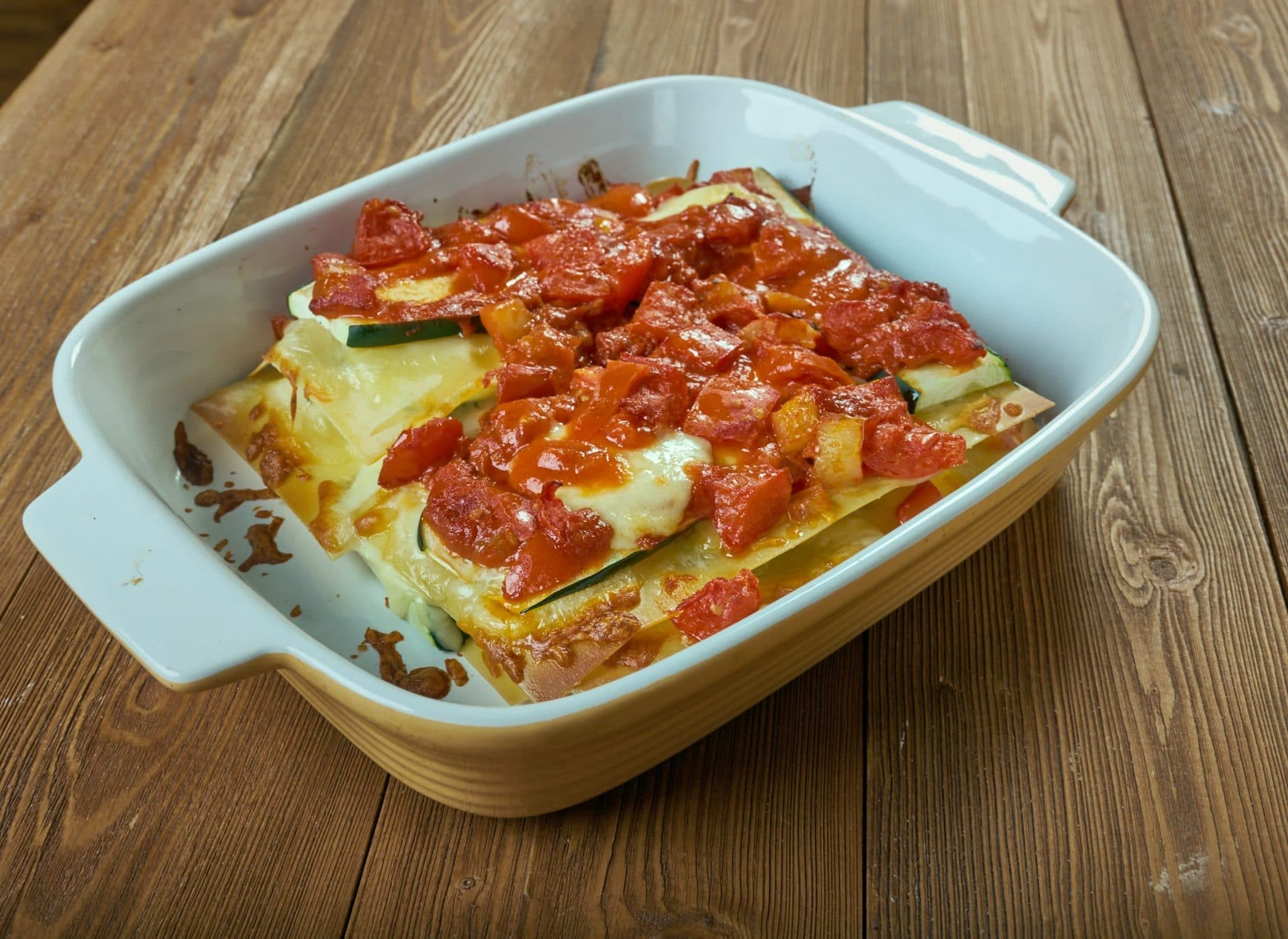 Zucchini Lasagna top side view in a tan casserole dish