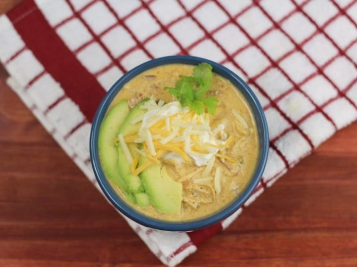keto white chicken chili in a blue bowl shot from the top