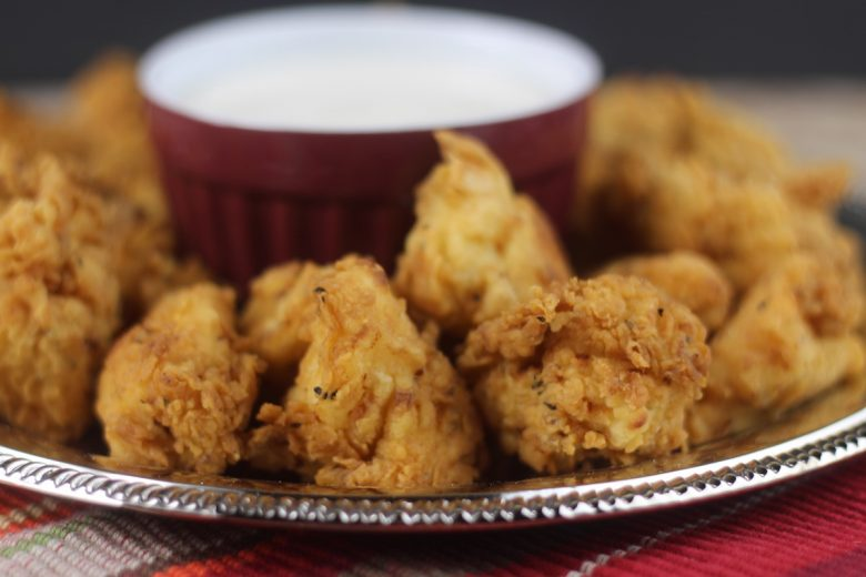 chicken nuggets on a platter with ranch dipping sauce