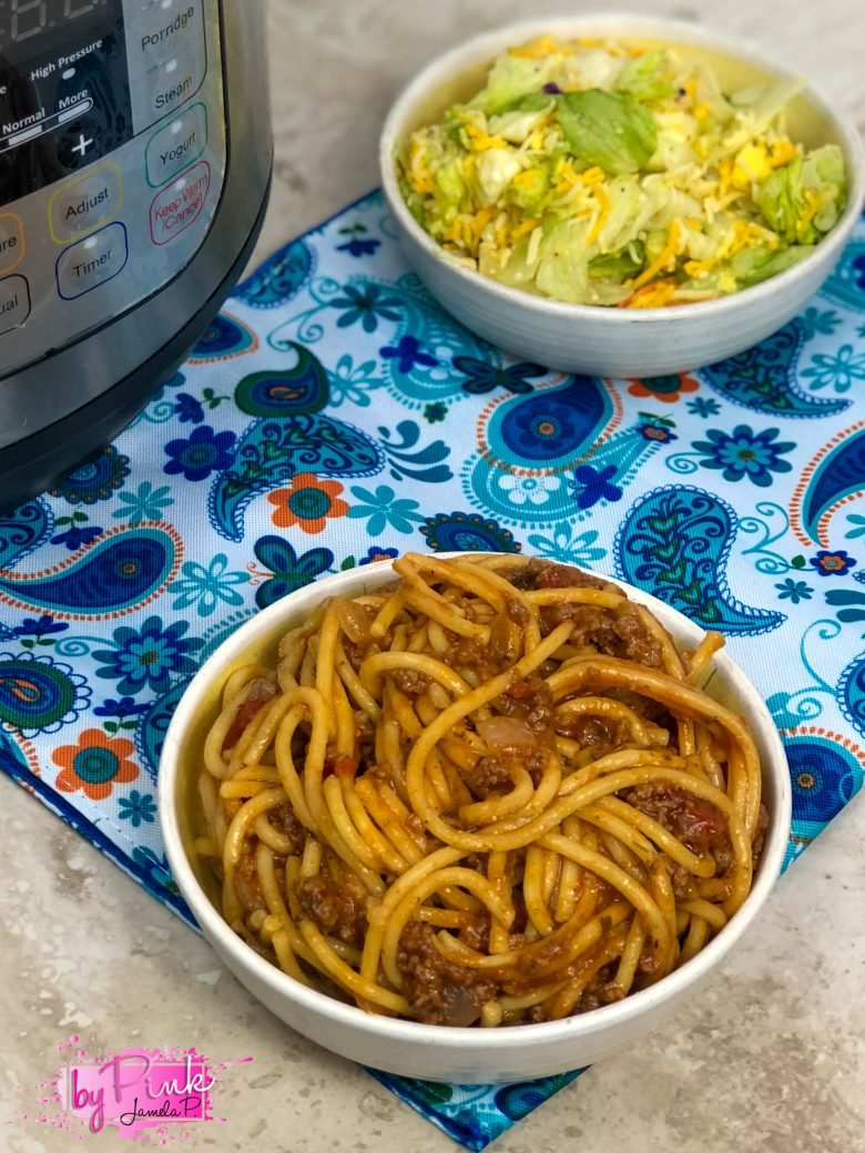Close up of pressure cooker spaghetti on a blue paisley placemat