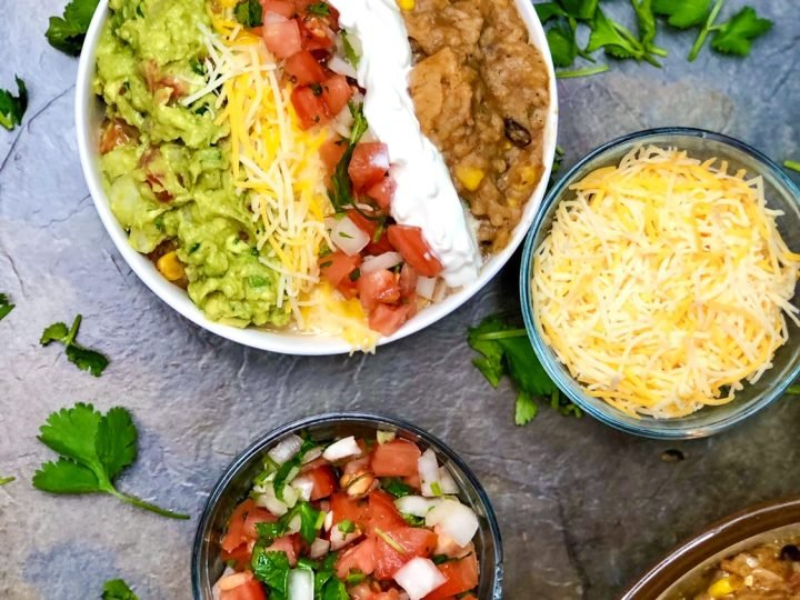 top view instant pot chicken burrito bowl with toppings