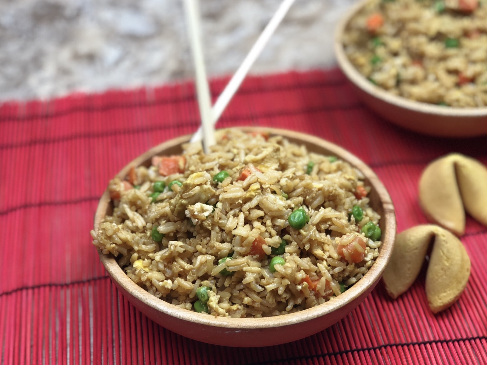 Forget ordering takeout and make your own Instant Pot Fried Rice that tastes better than takeout!  This fried rice in your instant pot is a straightforward recipe that gives your takeout flavors in under 10 minutes to make. #friedrice #instantpot #easy #easyrecipe #carrots #peas