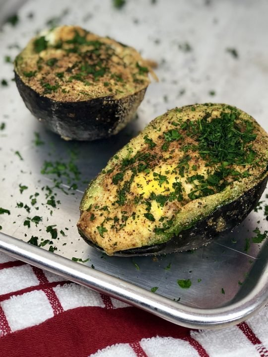 Air Fryer Baked Avocado Egg. Is what dreams are made of. Astuffed avocado filled with an egg and seasonings that make a perfectly healthy breakfast. And bonus, this avocado egg is low carb and keto! #lowcarb #keto #avocado #egg #airfryer