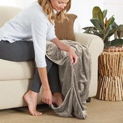 """The Footsac blanket makes the perfect holiday gift! Along the bottom of the blanket is an 18"""" pocket to tuck your feet in, which means that you will never again struggle to keep your whole body warm, cozy and covered."""