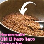pin image of homemade taco seasoning in a wooden bowl with pink text over lay