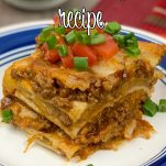 side view of mexican taco lasagna with text overlay