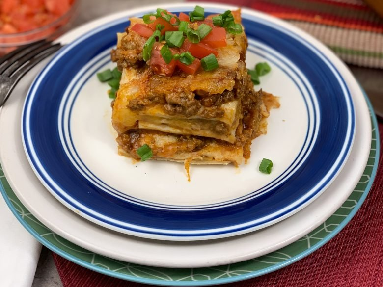 mexican lasagna on 3 stacked plates