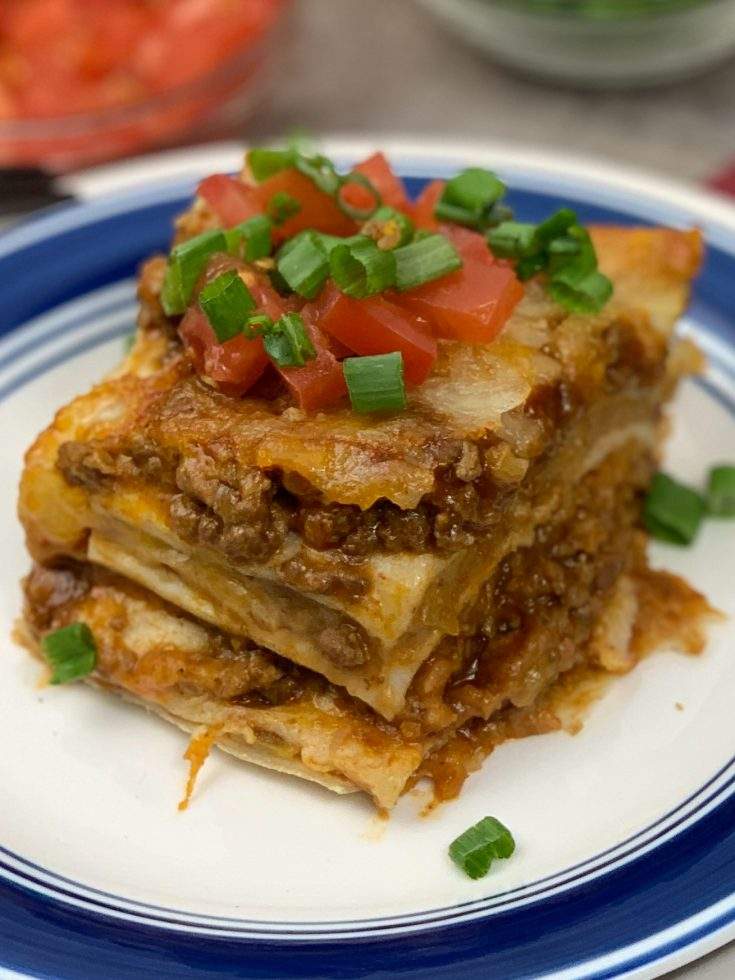 This Mexican Lasagna Recipe is an amazing way to switch up taco Tuesday. Mexican Lasagna is a great infusion of Mexican spices and flavors that your family will love! #mexicanfoodrecipes #mexican #mexicanfood #lasagna #airfryer #tacotuesday #taco