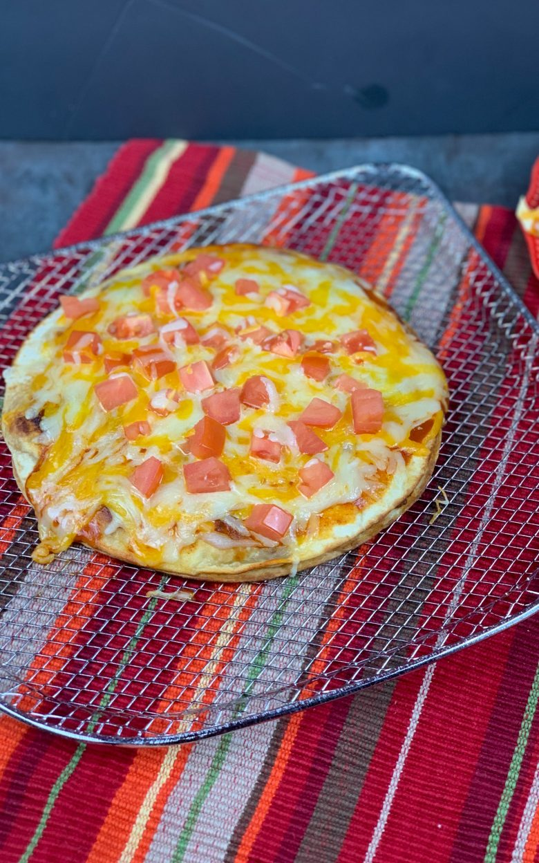 mexican pizza on a wire rack