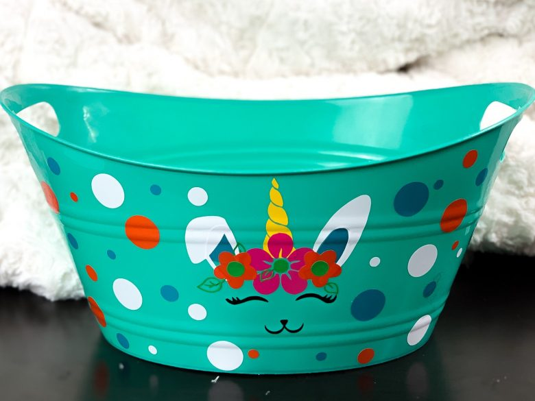 teal diy dollar tree easter basket with bunnicorn and colorful dots and glue with peeking bunny and colored dots