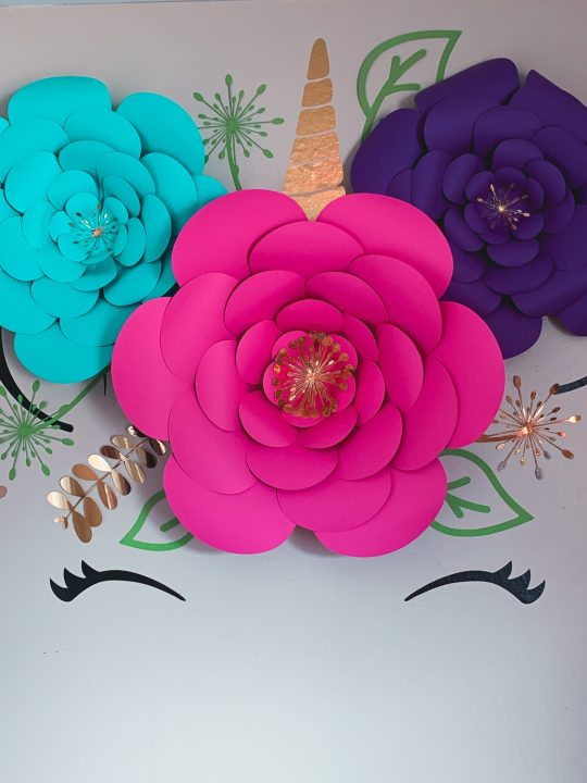 diy of unicorn wall decal with real pink and purple flowers and gold accents