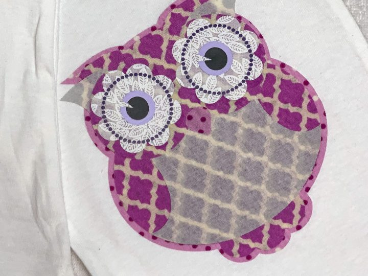 top view of owl fabric applique onsie