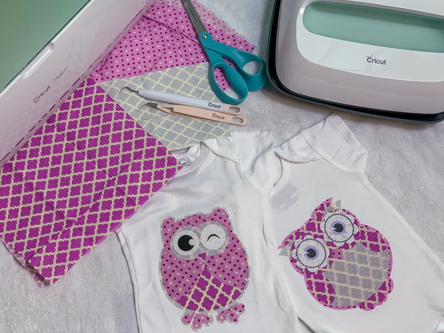 top view of cricut maker with fabric pieces and easy press 2 to make owl fabric appliques