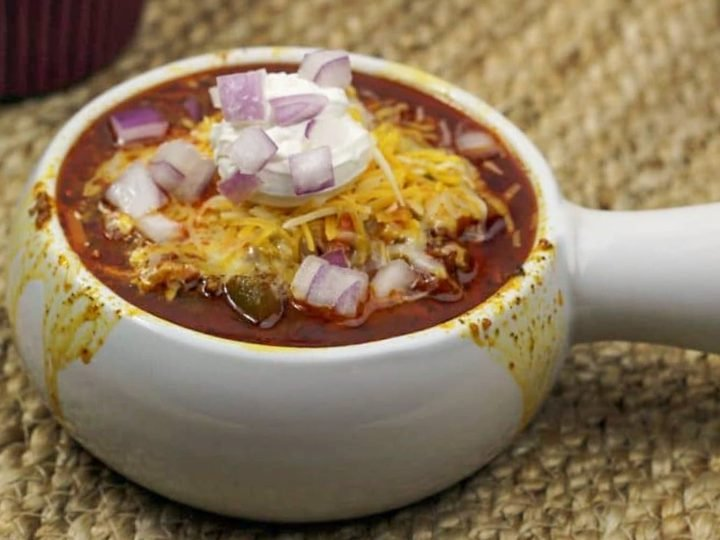 white chili bowl with toppings in back