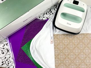 cricut maker and cricut easy press with supplies to make cricut projects