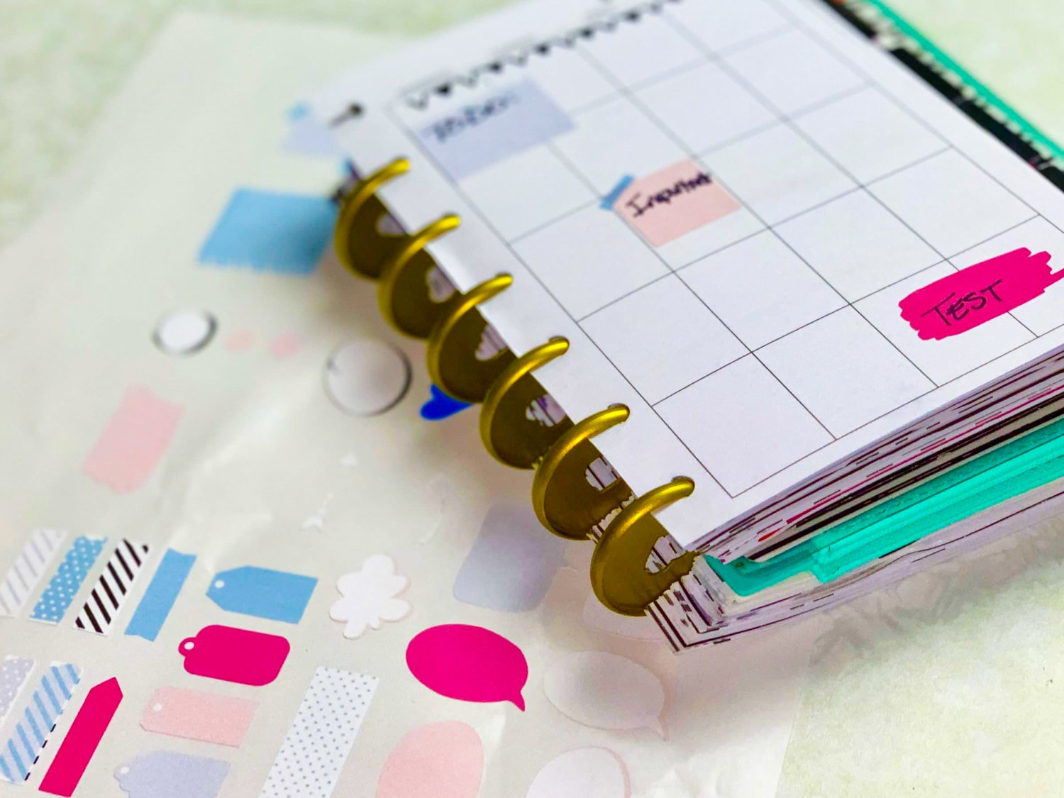 cricut stickers next with a happy planner on top of them