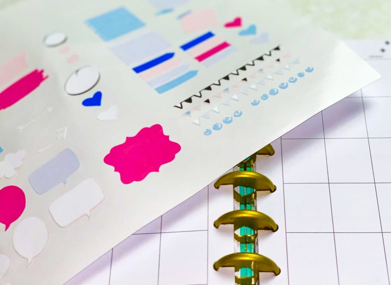 close up of happy planner with printable planner stickers made with cricut