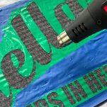 heat gun heating green vinyl for doormat diy