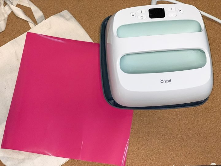 EasyPress 2 next to a canvas tote with pink htv next to it
