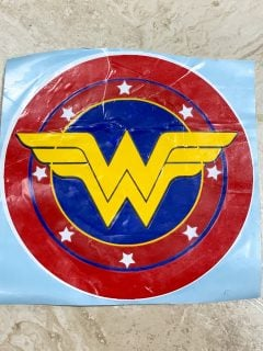 wall decal made from the red, white, blue and gold wonder woman logo