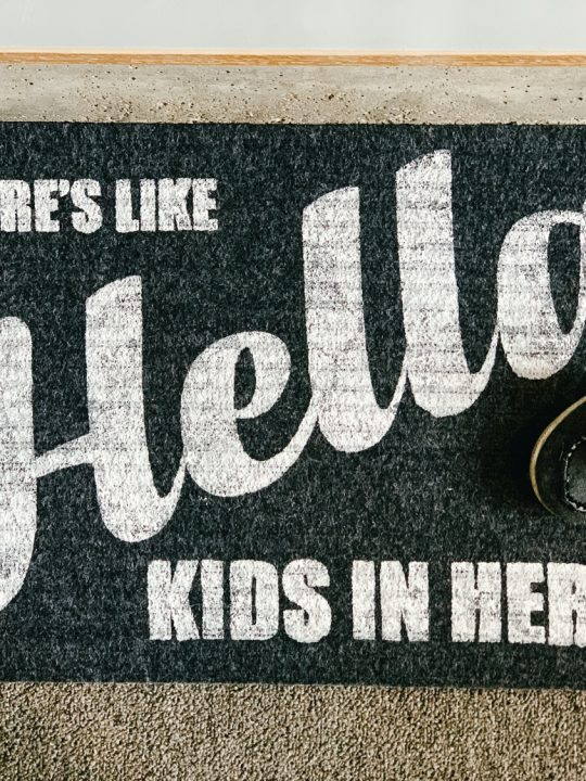 finished gray dollar tree doormat with white letters