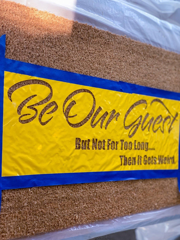 yellow vinyl placed on a coir mat to make a diy door mat