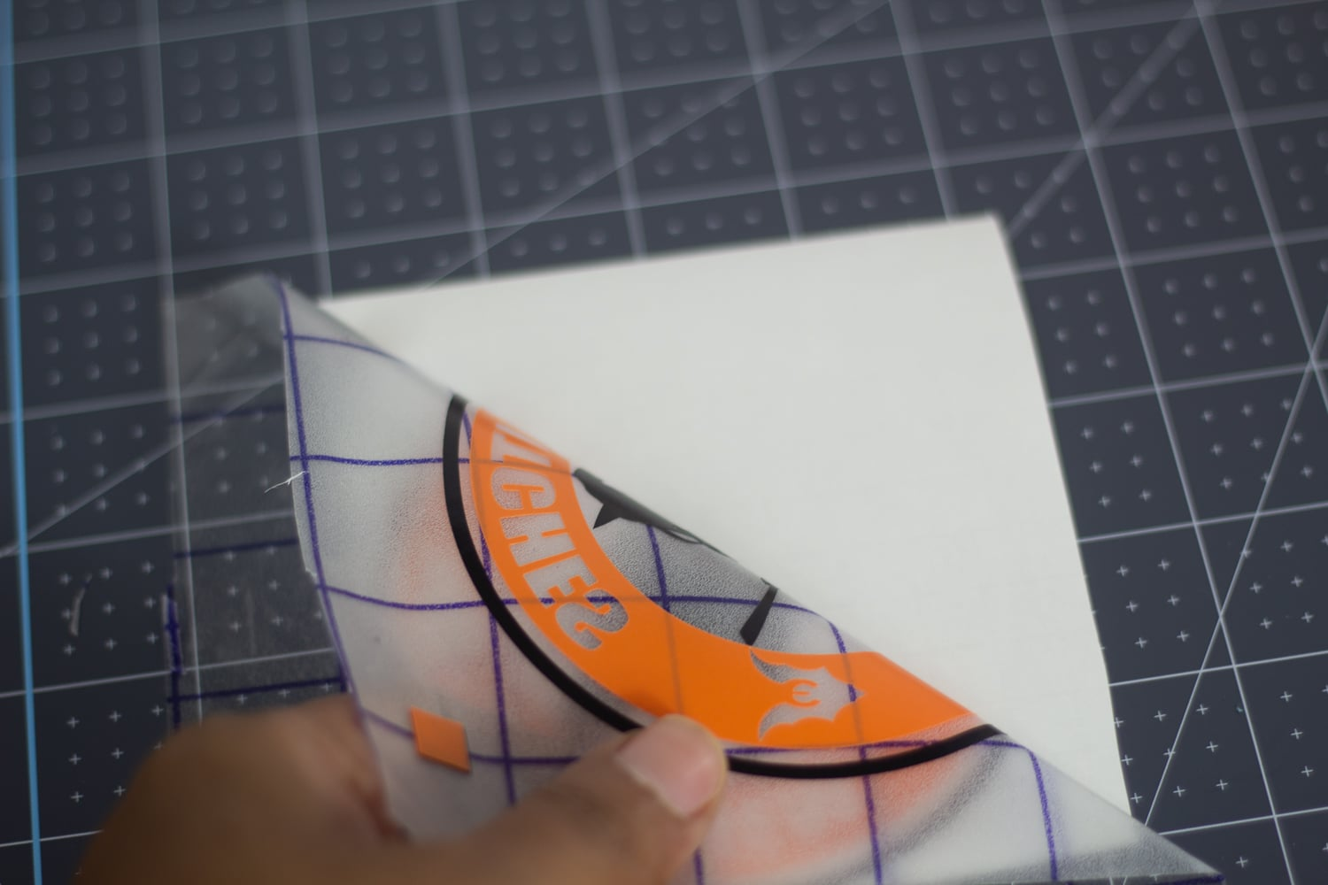 peeling adhesive vinyl from paper backing