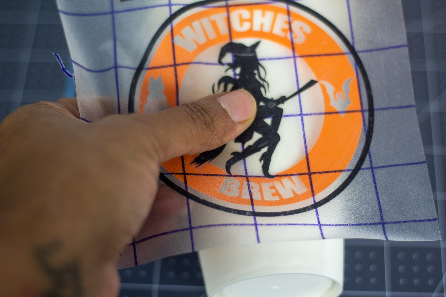 placing layered vinyl on a cup
