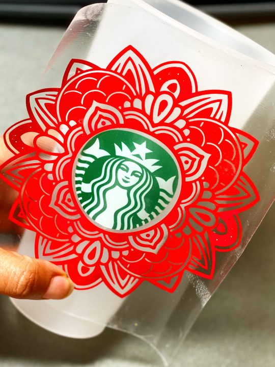 custom starbucks cup with a red design made from a mandala svg