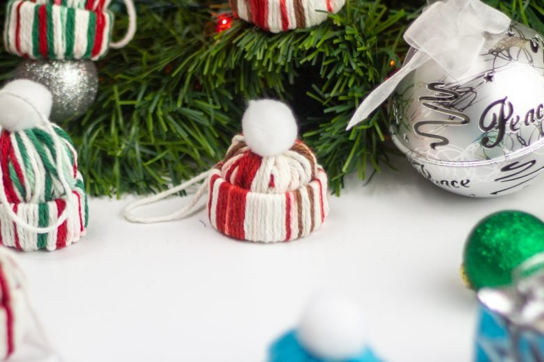 winter hat diy christmas ornaments make from red green and white yarn and toilet paper rolls