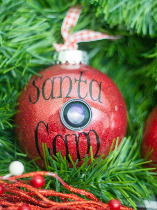 red santa cam ornament with real lens and black lettering