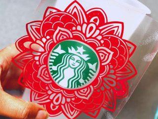hand holding a custom starbycks cup with mandala svg