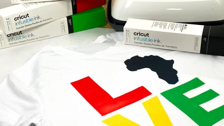 cricut infusible link tshirt with the word love in red, yellow and green with africa in black