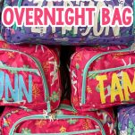 stacked duffle bags with vinyl lettering with text which reads how to make a personalized overnight bag