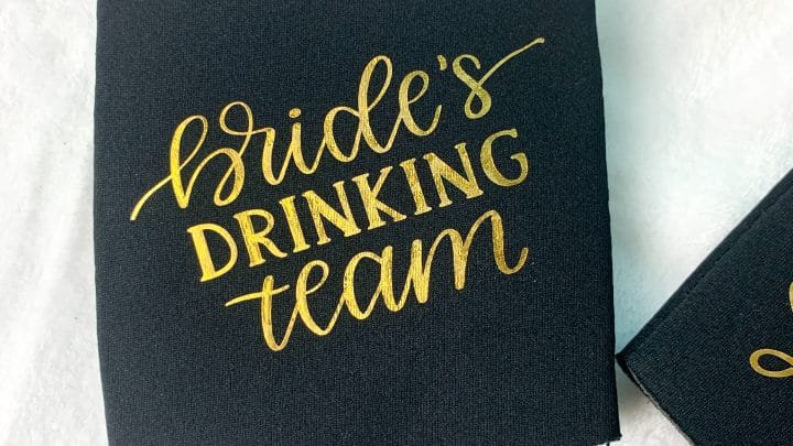overhead view of black drink koozies with vinyl lettering
