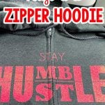 grey hoodie with a zipper with vinyl lettering with text which reads how to apply vinyl to a zipper hoodie