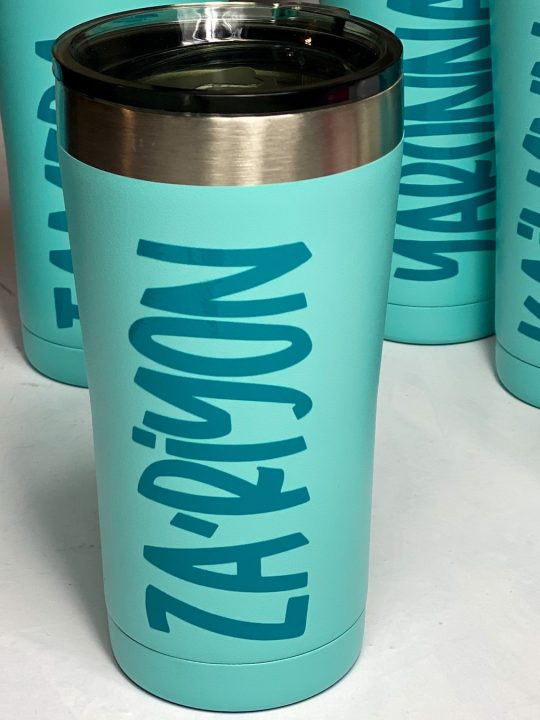 teal blue personalized coffee cups on a white table