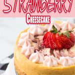 side view of strawberry swirl instant pot cheesecake recipe on a white cake plate with text which reads instant pot strawberry cheesecake