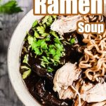 closeup of chicken soup with ramen noodles with text which reads thai chicken ramen soup