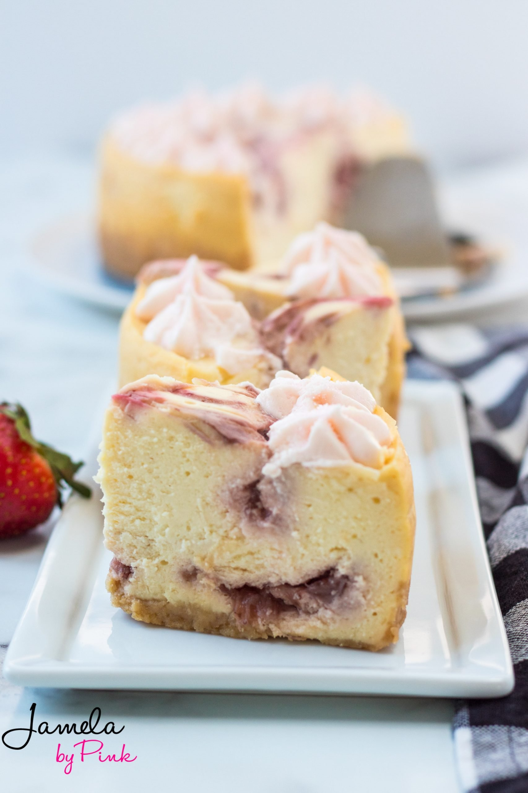 closeup of slices of strawberry swirl instant pot cheesecake recipe