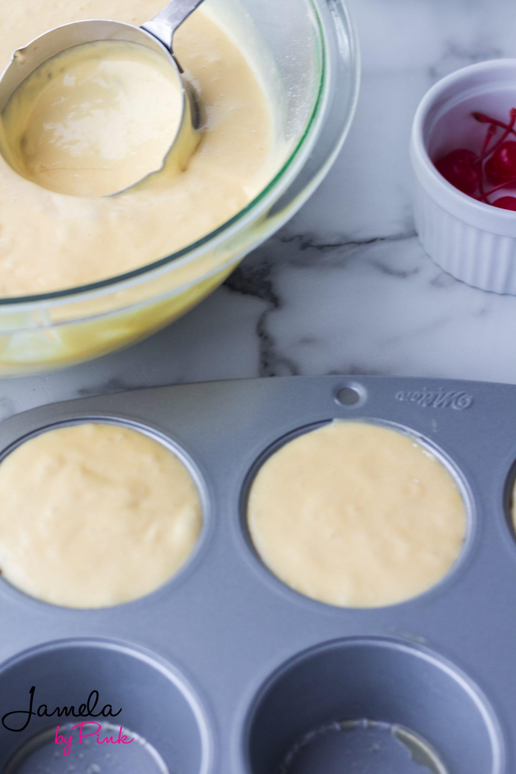 mini pineapple upside down cake batter in tins