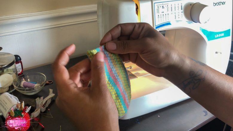 sewing the ends of a facemask