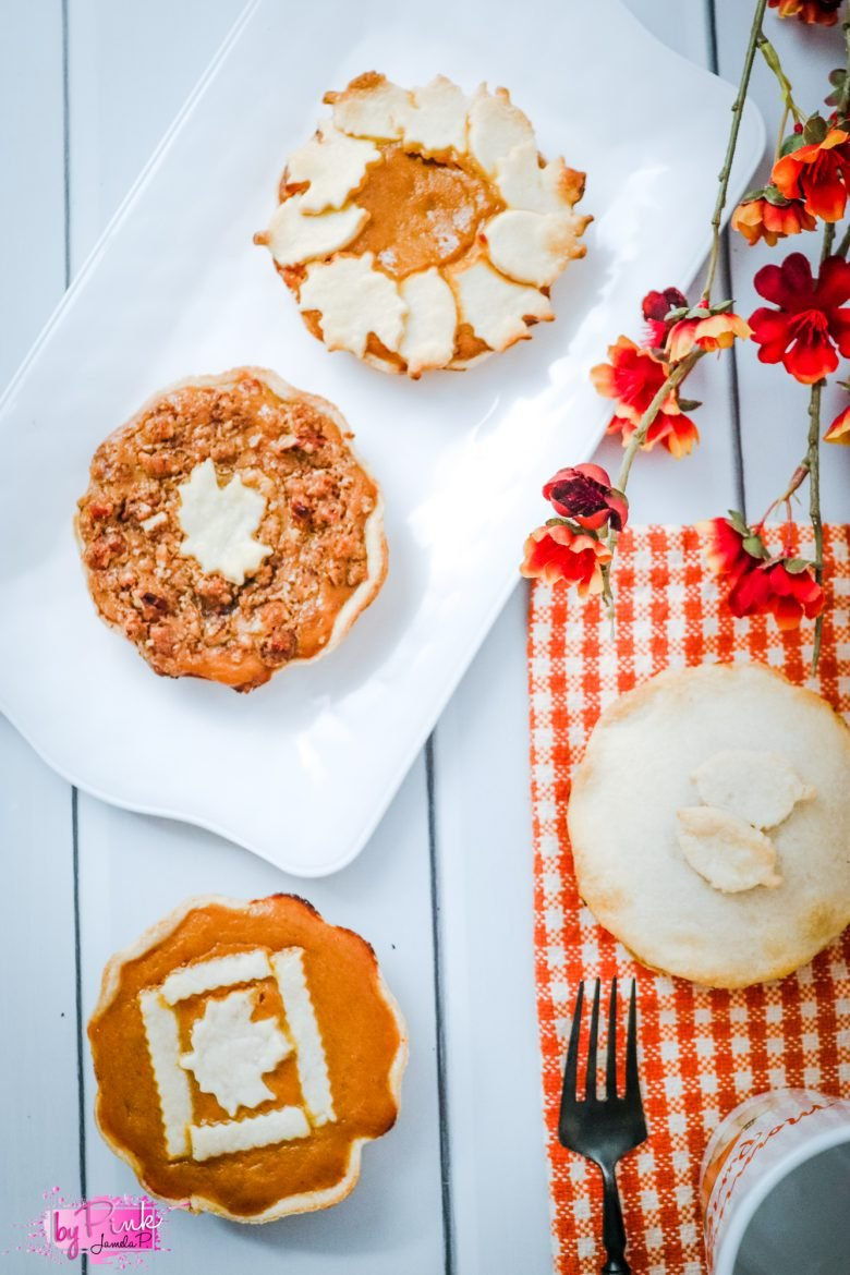 mini pumpkin pies with fall leaf designs on top