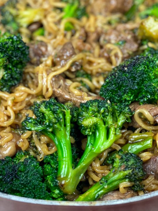 beef ramen stir fry with broccoli florets in bowl