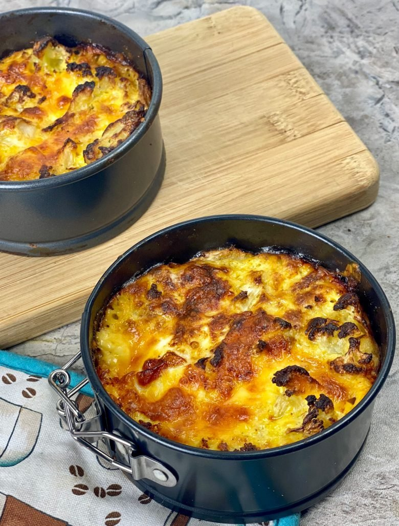 two baking pans with keto mac and cheese cooked until golden brown
