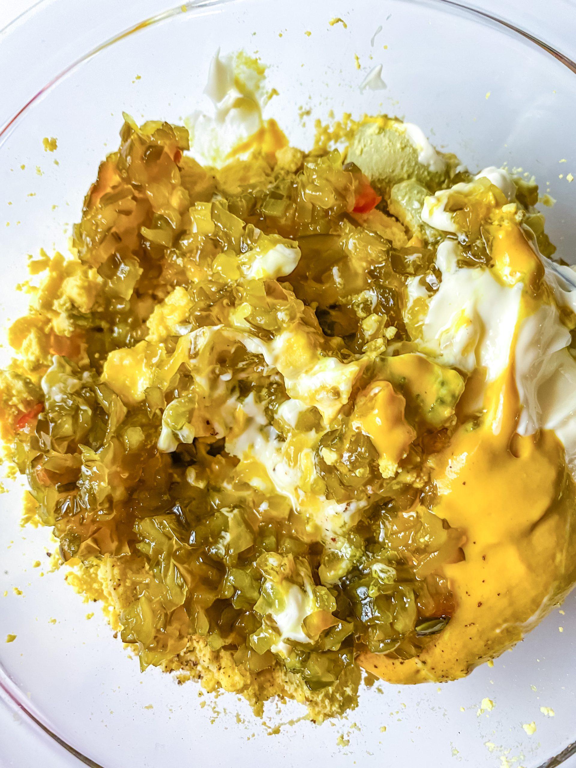 egg yolks mashed in a bowl
