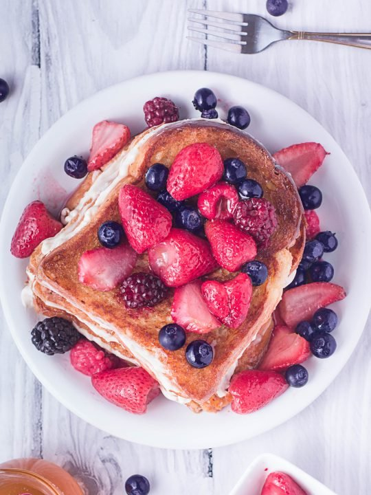 stuffed french toast recipe topped with fresh berries